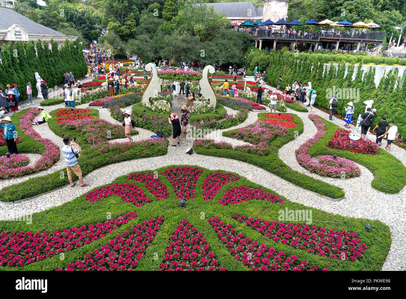 Tourists visit the beautiful flower garden of ba na hill ba na hill tourists visit the beautiful flower garden of ba na hill ba na hill mountain resort is a favorite destination for many tourists izmirmasajfo