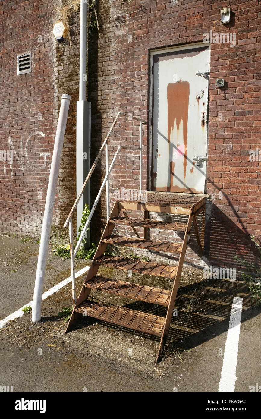 Rusty Metal Staircase Into Abandoned Industrial Building.   Stock Image