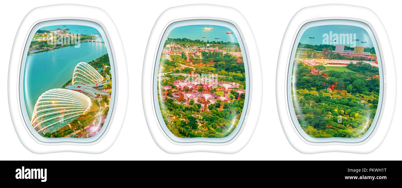Porthole windows flying on Singapore bay. Scenic flight above gardens by the bay skyline. Night urban aerial scene with copy space on white background. - Stock Image