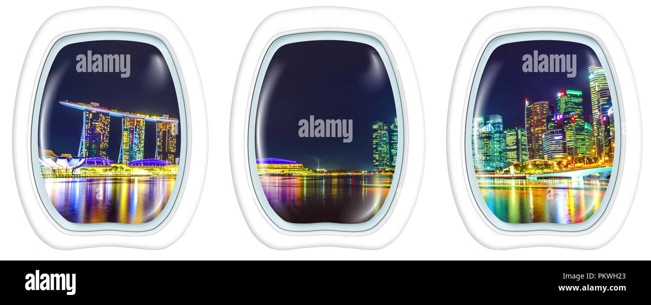 Plane cabin interior flying on Panorama of Singapore buildings and skyscrapers of downtown by the sea. Singapore scenic flight by night. Night scene waterfront of marina bay, copy space on white. - Stock Image