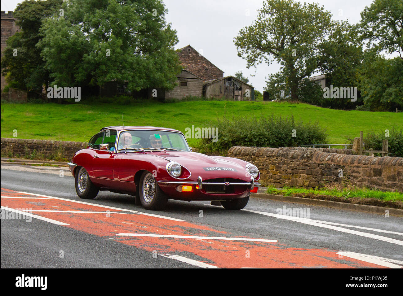 Red 1969 Jaguar 'E' Type Classic, vintage, veteran, cars of yesteryear, restored collectibles at Hoghton Tower Class Cars Rally, UK - Stock Image