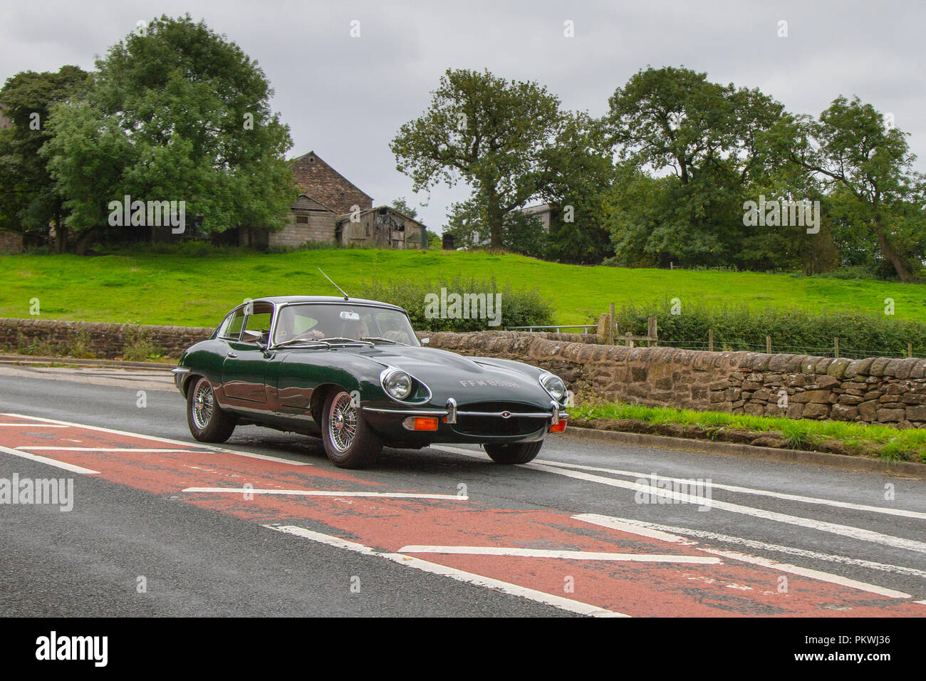 Green 1970 Jaguar Classic, vintage, veteran, cars of yesteryear, restored collectibles at Hoghton Tower Class Cars Rally, UK - Stock Image
