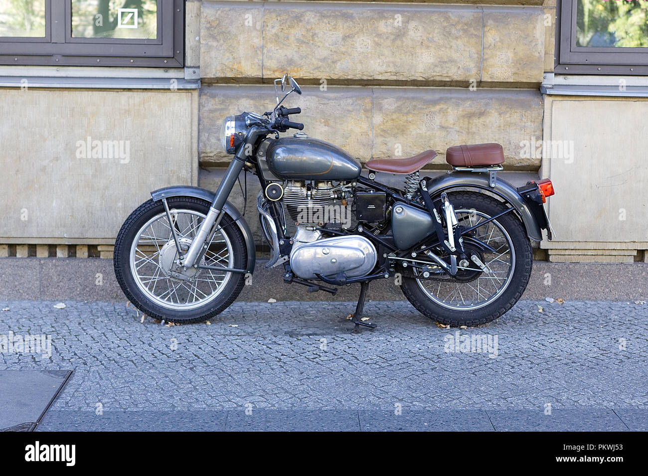 Royal Enfield Motorcycle parked on a pavement on the streets of Berlin - Stock Image