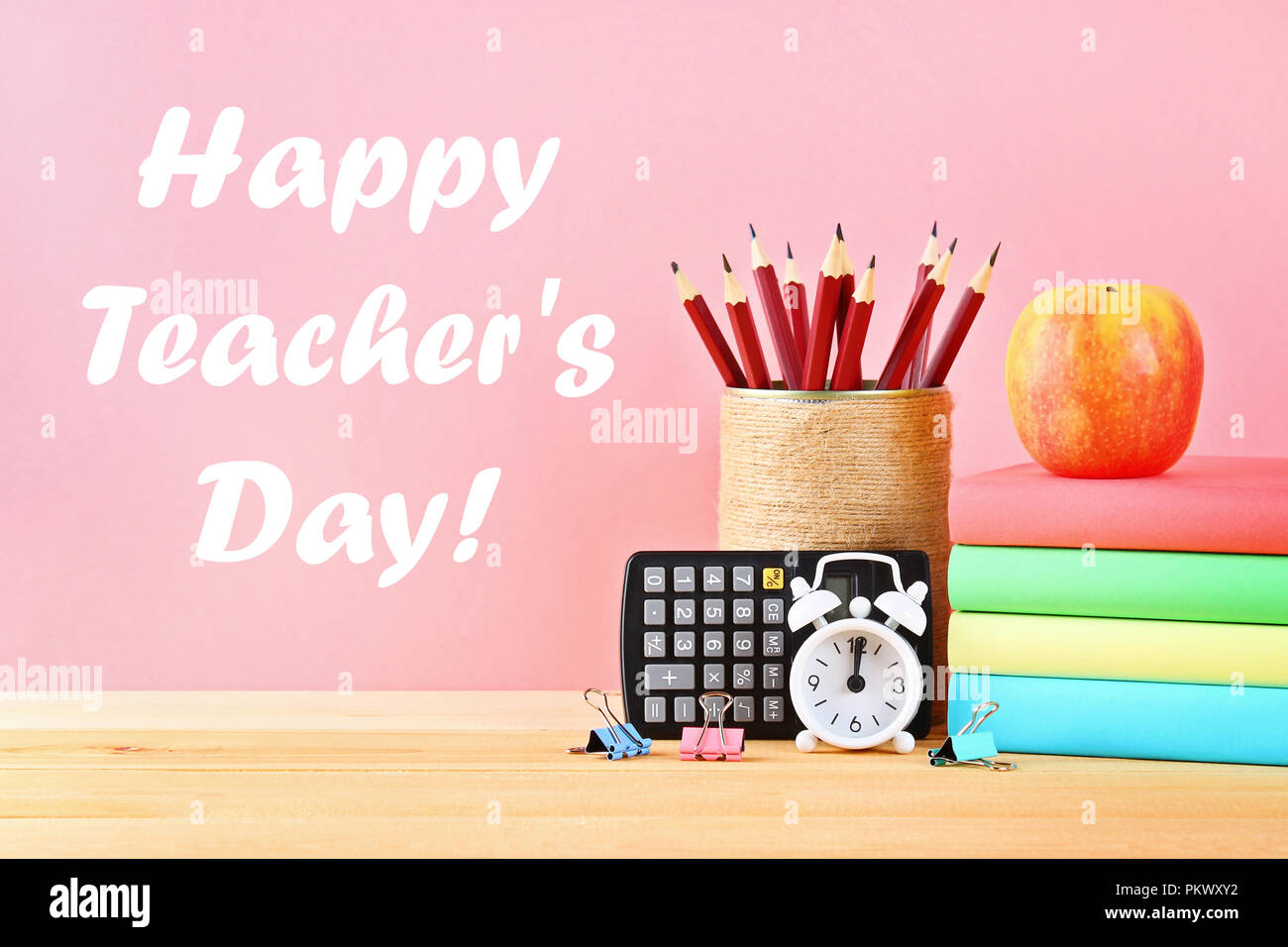Happy Teachers Day  School and office supplies on a pink