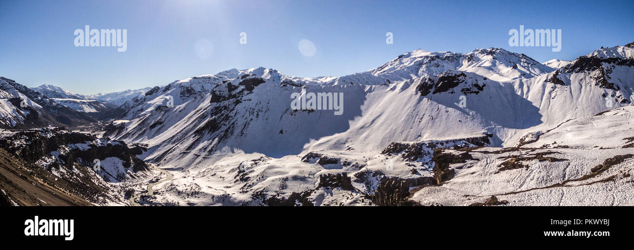 Snowy chilean argentine mountains Andes. Aerial Panoramic view - Stock Image