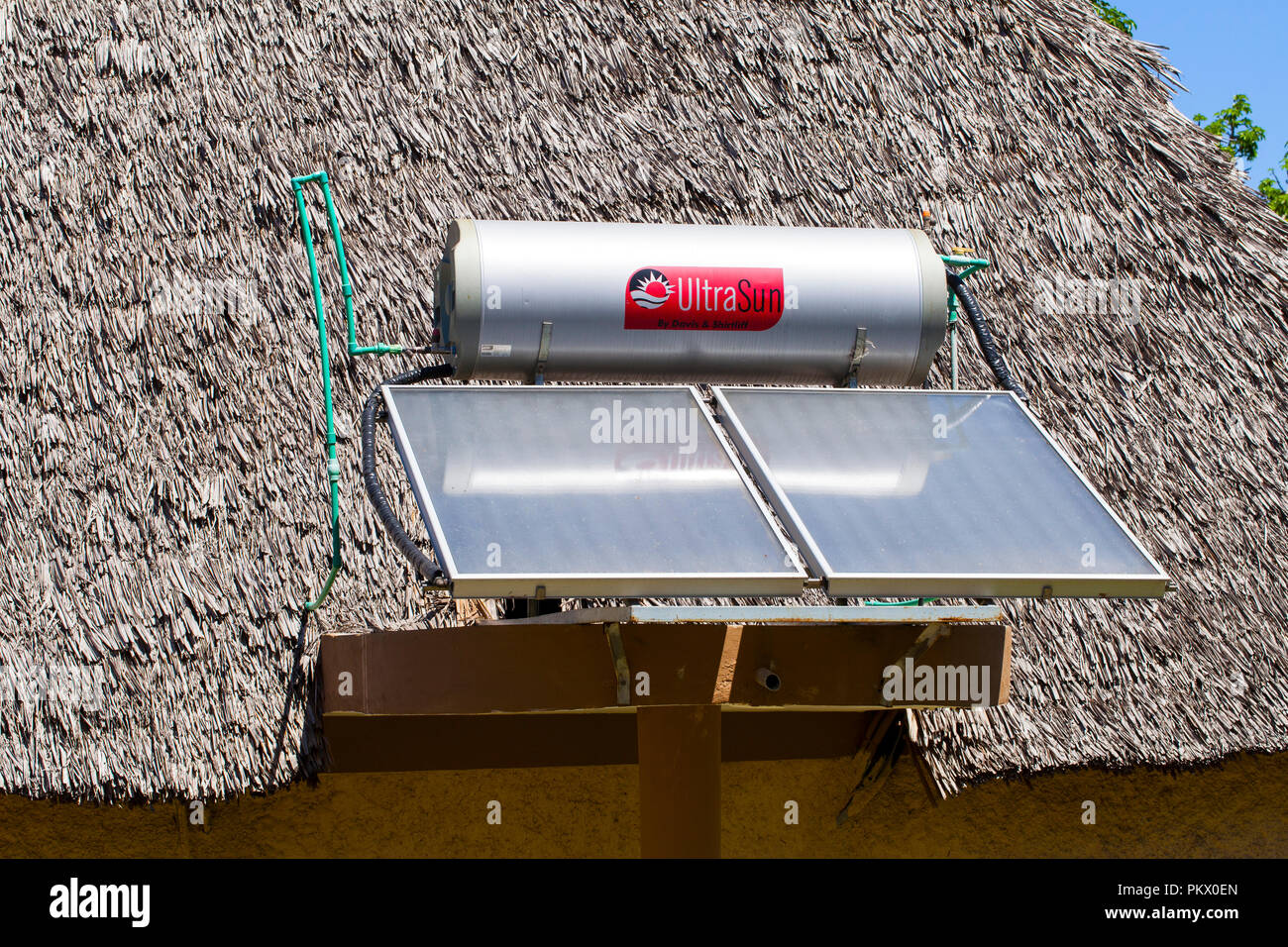 GALU - KINONDO BEACH, KENYA - FEBRUARY 26, 2018: Systems for heating water from sunlight ( sun collectors) on roofs of hotel Neptune Paradise Beach Re - Stock Image