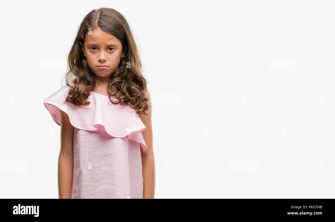 58cc076b13bf Brunette hispanic girl wearing pink dress depressed and worry for distress,  crying angry and afraid. Sad expression.