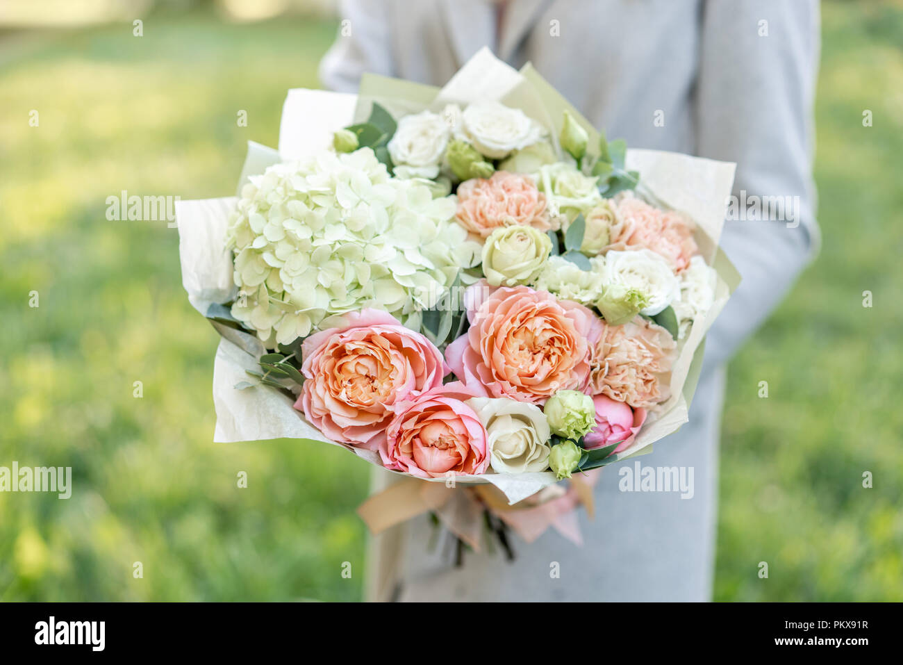 Close Up Beautiful Spring Bouquet In Hands Delicate Flower