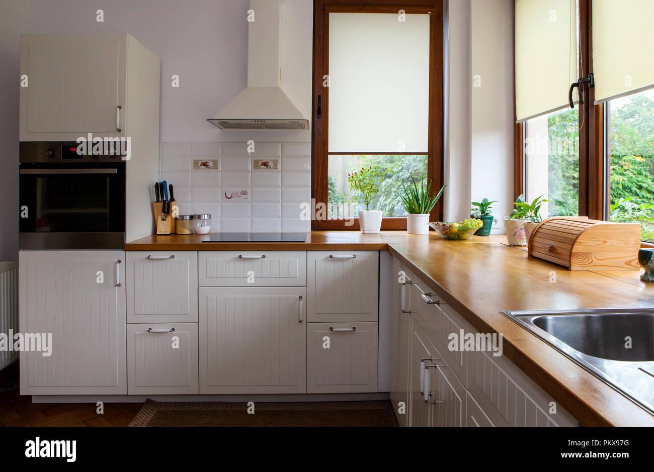 Interior of white modern kitchen - Stock Image