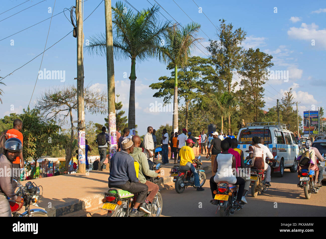 Busy City Street with Traffic and People, Transport, Transportation in Mbarara Town, Uganda, East Africa - Stock Image