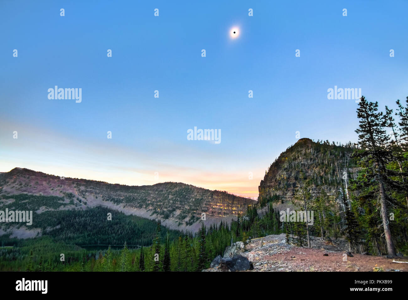 The sun turns into a black dot during a total solar eclipse on 8-21-17 in the Strawberry Mountains Wilderness, Oregon. - Stock Image