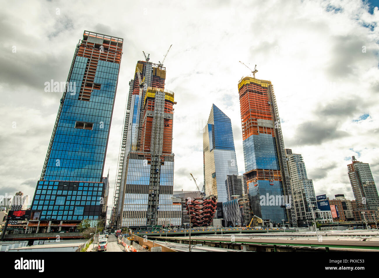 New York, USA, October 30, 2017: Hudson Yards train depot from the High Line. New York City skyline with urban skyscrapers in construction. View from  Stock Photo