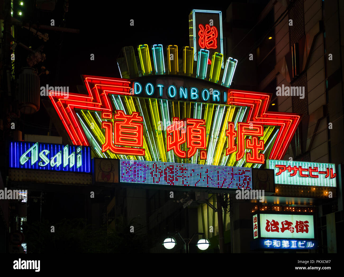 A neon sign in the Dotonbori district of Osaka, Japan. - Stock Image