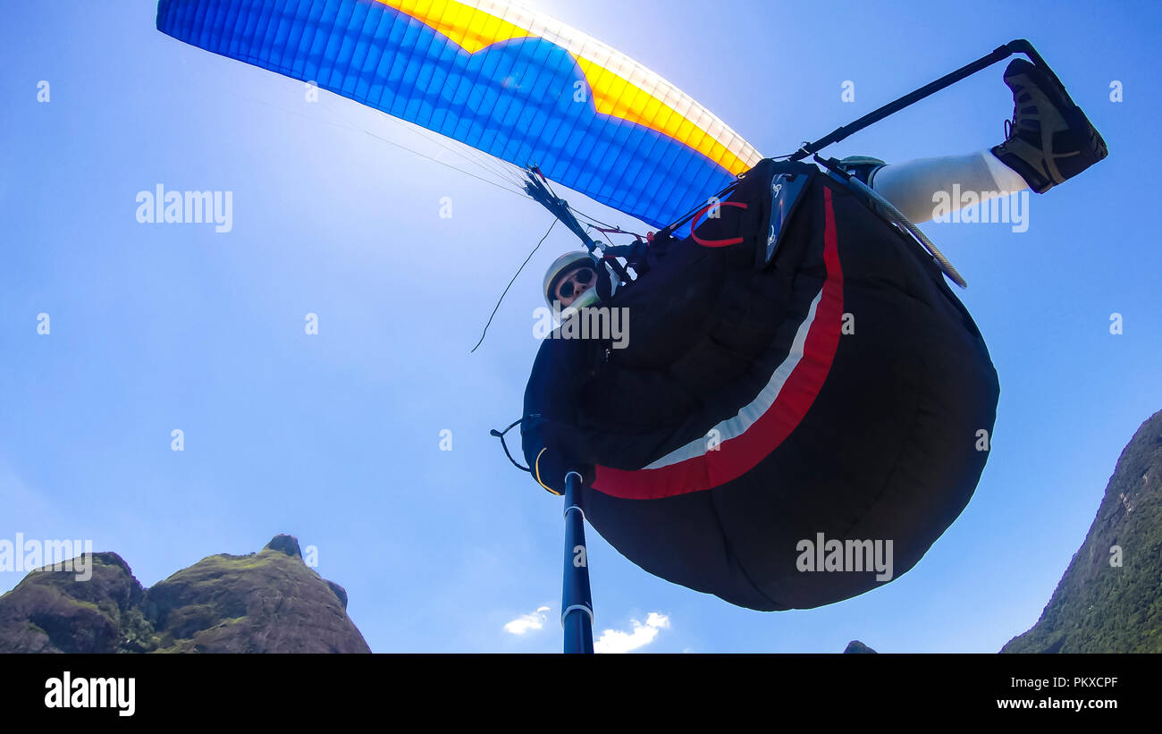 Paraglider pilot, physical handicapped, riding their own paragliding, pure adventure in Rio de Janeiro Brazil. Cultural diversity, handicapped man. Stock Photo