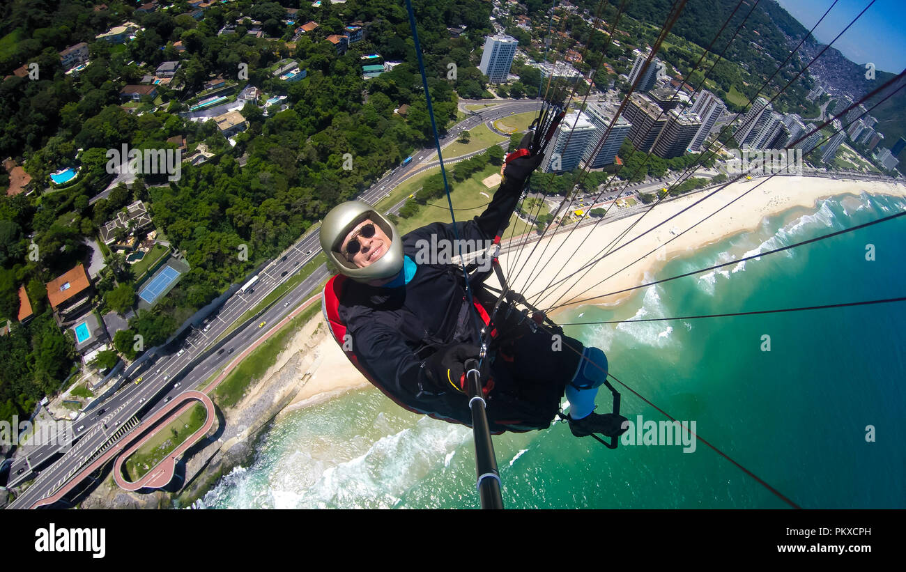 Paraglider pilot, physical handicapped, riding their own paragliding, pure adventure in Rio de Janeiro Brazil Stock Photo