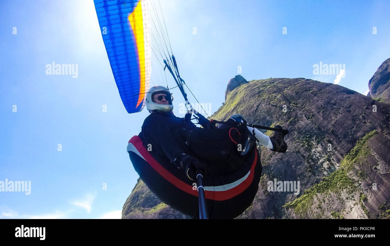Cultural diversity, handicapped man. Paraglider pilot, physical handicapped, flying in their own paragliding. Stock Photo