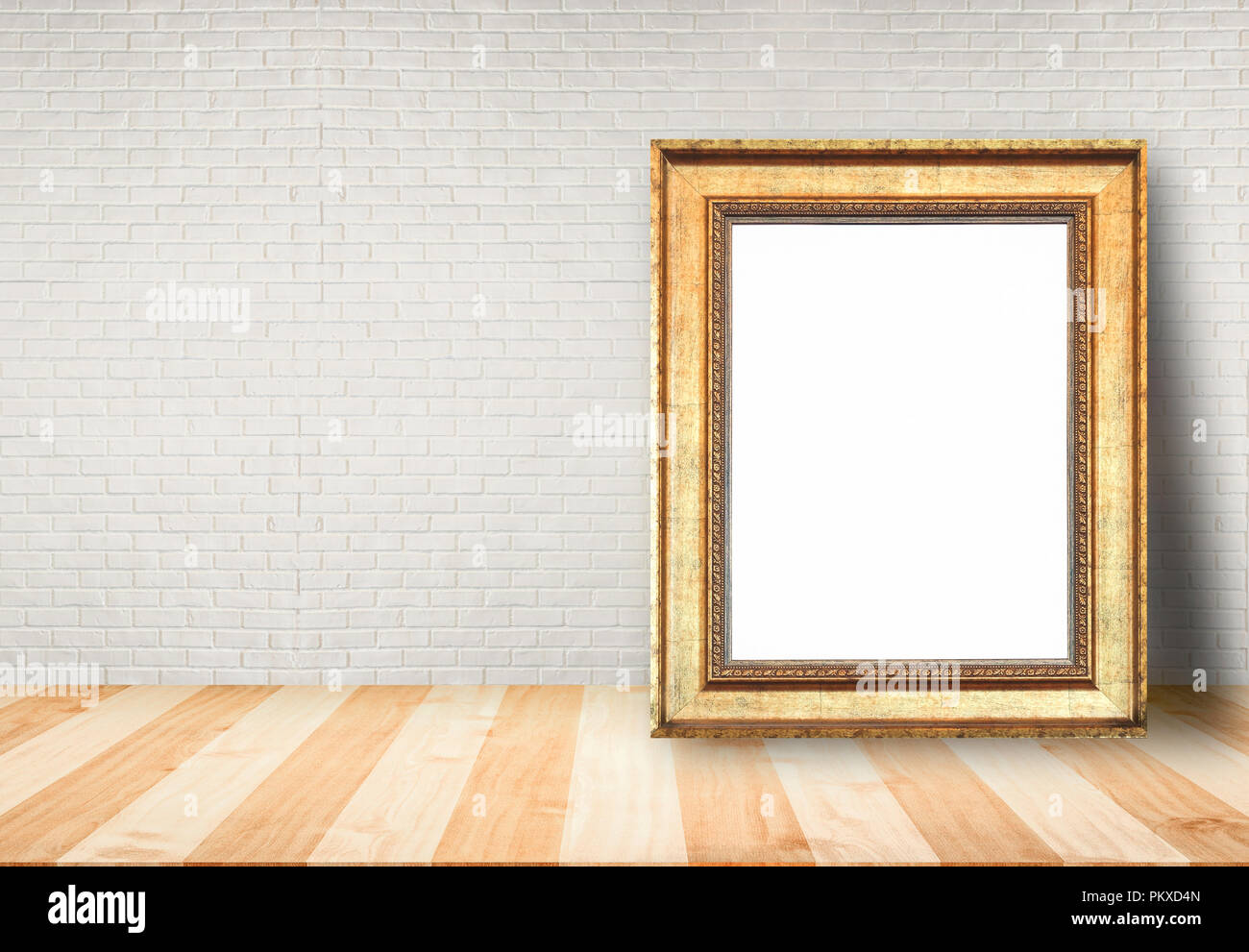 Close up blank picture frame put on table with brick wall background ...
