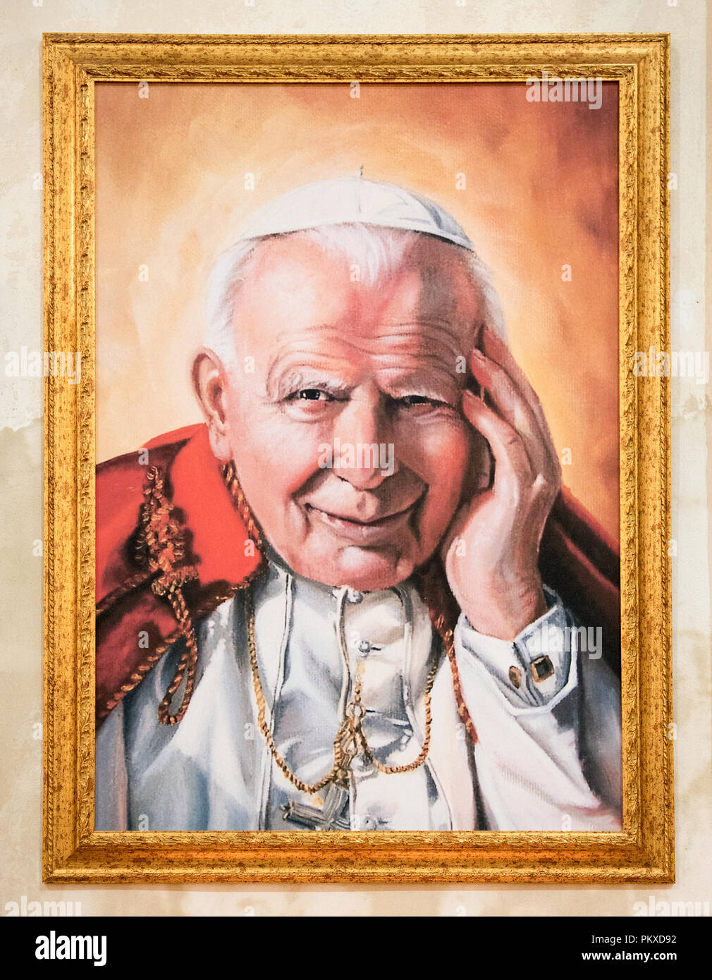 Portrait of Pop Giovanni Paolo II in a gold frame, the Bishop of Rome and Supreme Pontiff of the Catholic Church and Vatican - Stock Image