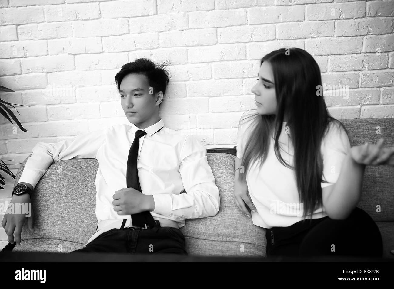 A pair of young people talking - Stock Image