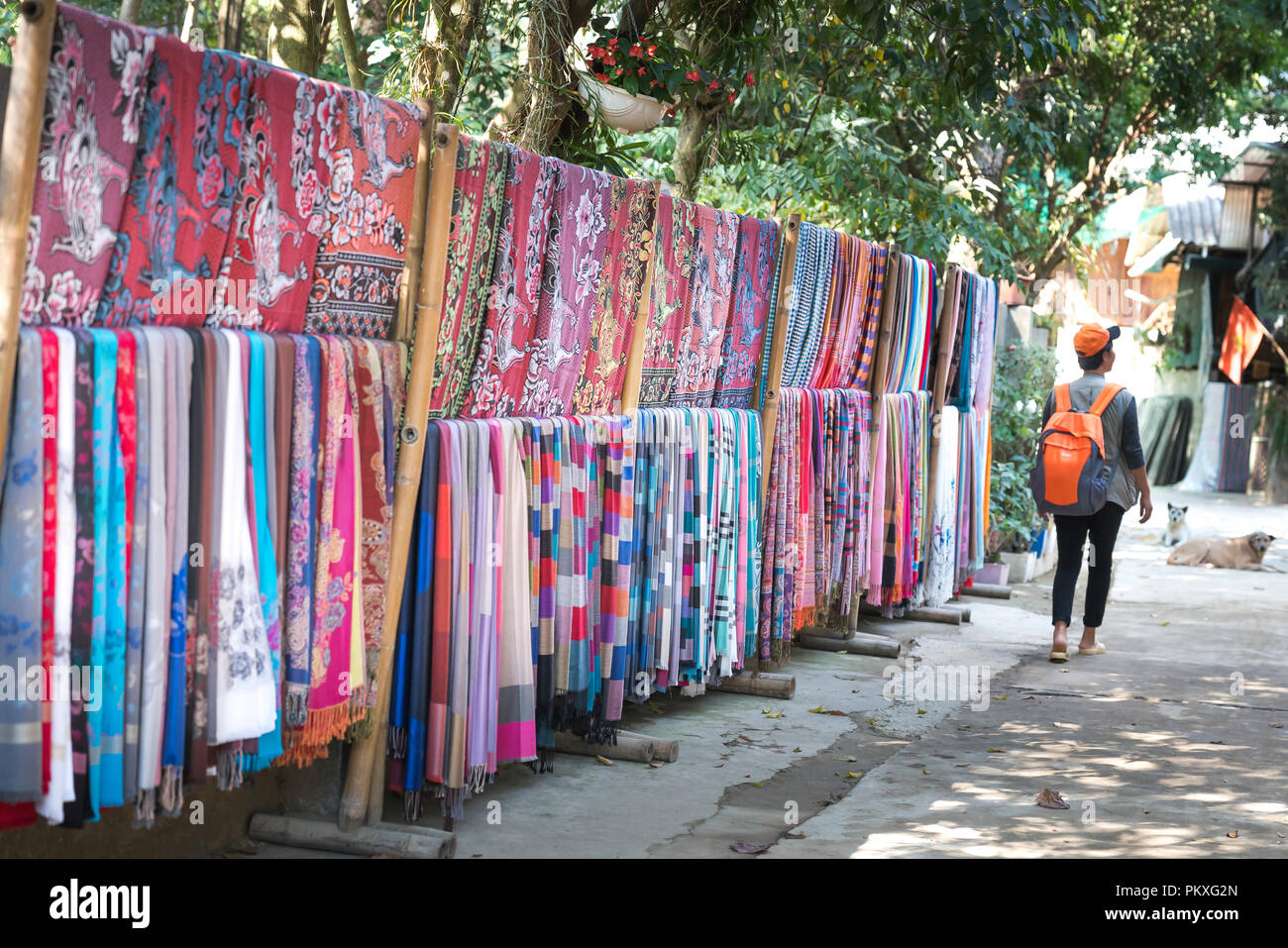 The shop selling handmade fabrics, skirts and brocade weaving made by Thai ethnic minority people. - Stock Image