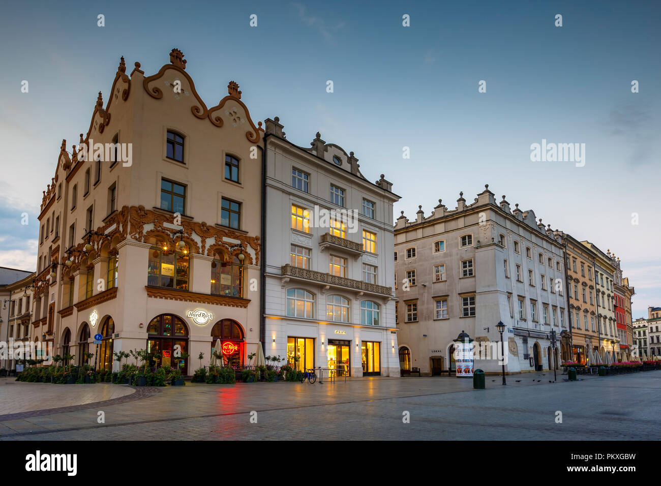 Krakow, Poland - August 23, 2018: Townhouses in the main square of Krakow, Poland. - Stock Image