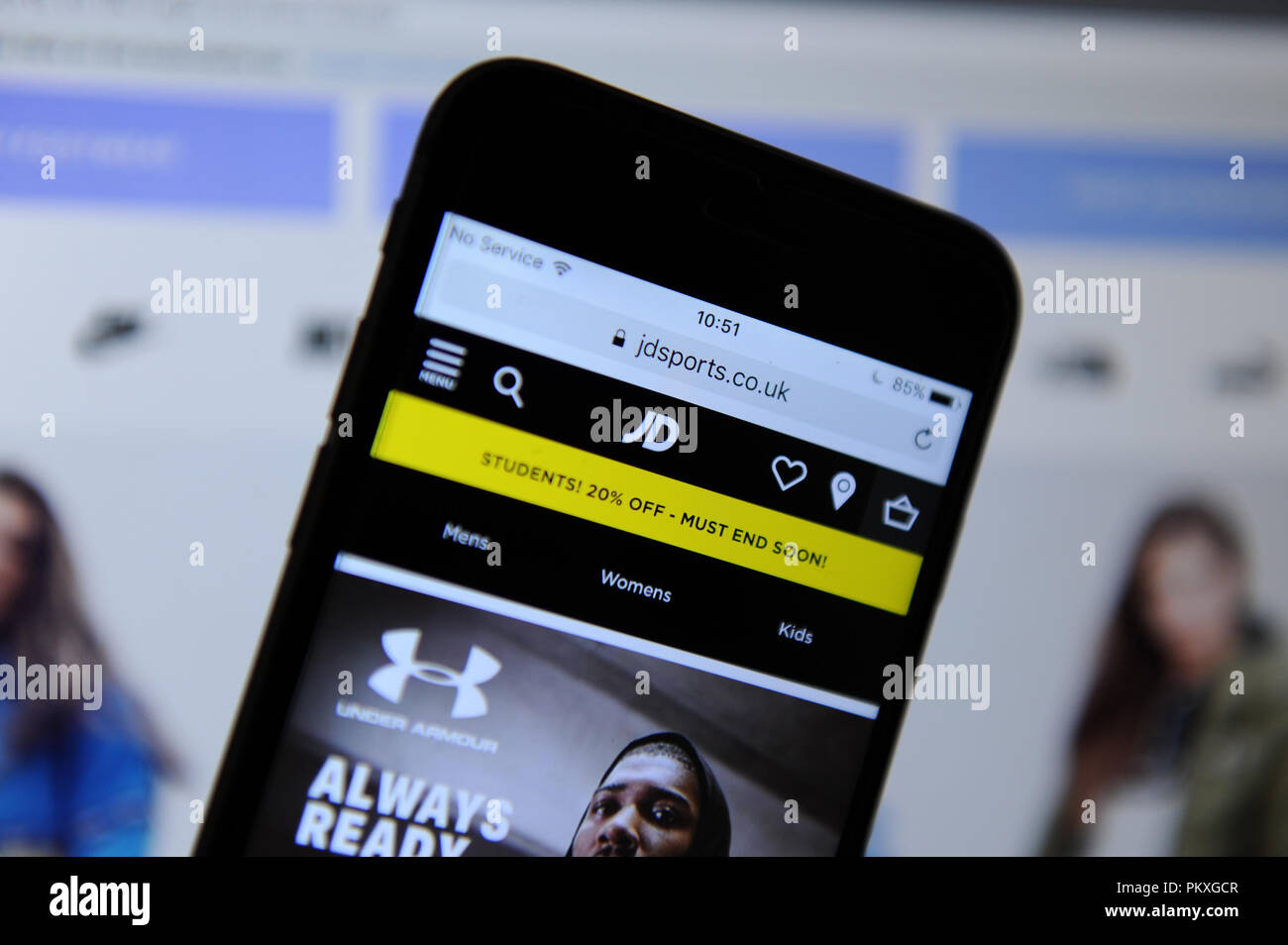 JD Sports website on a phone and website - Stock Image