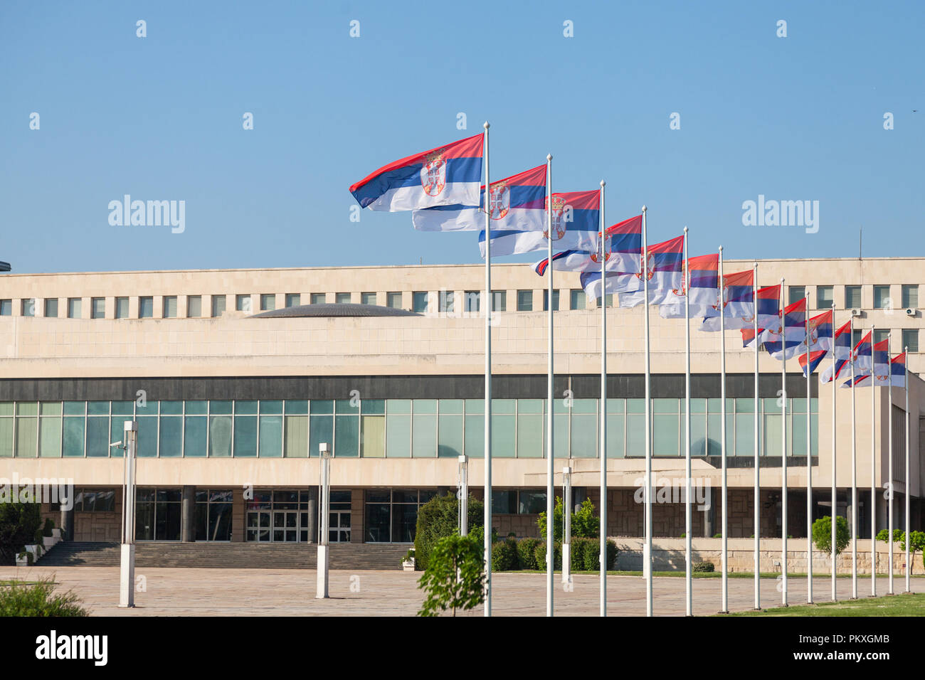 Flags of Serbia waiving in front of SIV, also known as Palata Srbija, or Palace of Serbia. It is the headquarters of the Serbian government, and the o - Stock Image