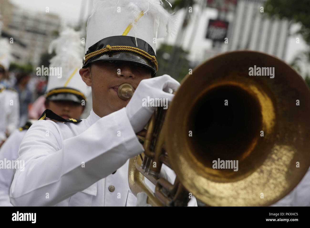 San Salvador, El Salvador. 15th Sep, 2018. Thousands of students celebrate with 'patriotic fervor' the 197th anniversary of the independence of El Salvador from Spain, a European country that currently maintains a close relationship with the region, in San Salvador, El Salvador, on 15 September 2018. Accompanied by musical bands, students offered folk dances, gymnastics and other exhibits to the attendees who arrived at the stadium carrying flags and other objects alluding to the date. Credit: Rodrigo Sura/EFE/Alamy Live News - Stock Image