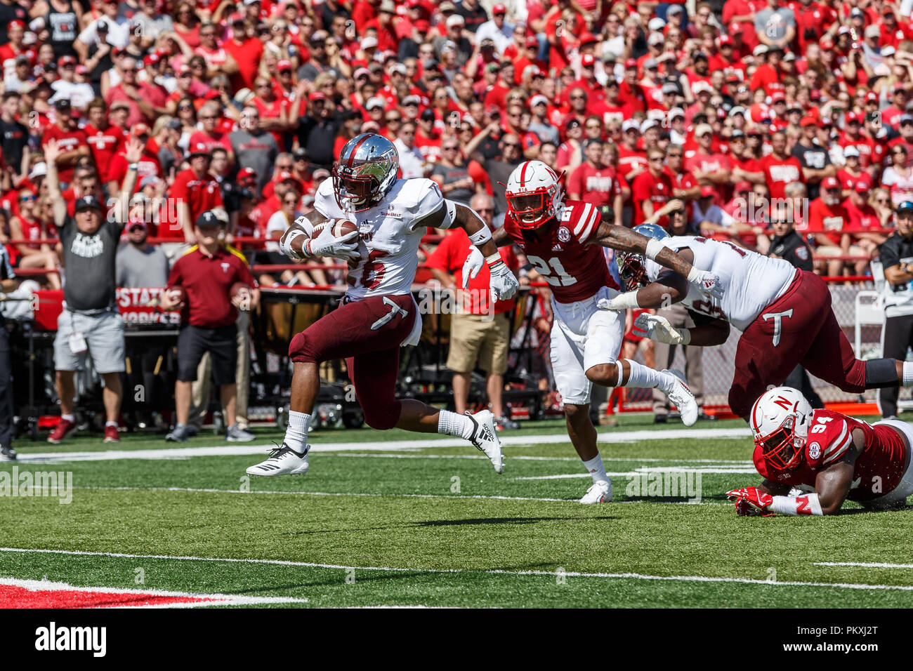 Lincoln, NE. U.S. 15th Sep, 2018. Troy Trojans running back B.J. Smith #26 rushes for his 4th quarter touchdown during a NCAA Division 1 football game between Troy Trojans and the Nebraska Cornhuskers at Memorial Stadium in Lincoln, NE.Attendance: 89,360.Troy won 24-19.Michael Spomer/Cal Sport Media/Alamy Live News - Stock Image
