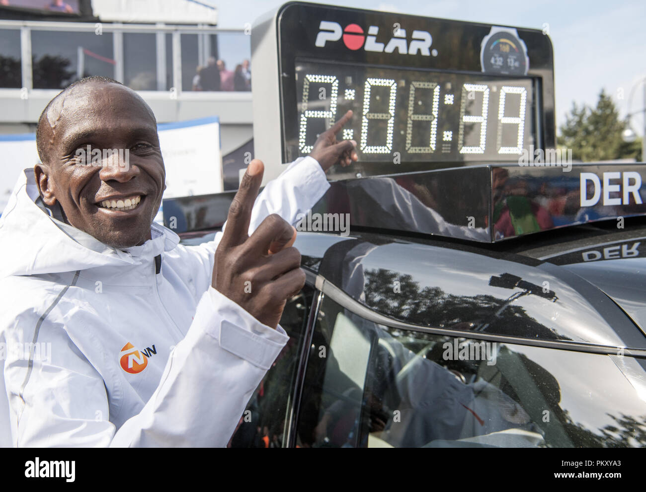 Berlin, Germany. 16th September 2018. The Kenyan Eliud Kipchoge is happy about his world record time of 2:01:39 during the award ceremony at the 45th BMW Berlin Marathon. Photo: Soeren Stache/dpa Credit: dpa picture alliance/Alamy Live News Credit: dpa picture alliance/Alamy Live News - Stock Image