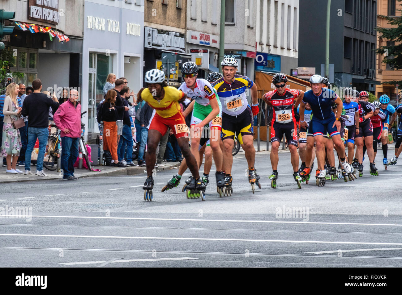 Berlin Germany, 15 September 2018. Annual Inline Skating Marathon. In line skaters pass through Rosenthaler Platz as they compete in the annual roller skating event. The event is the Grand Finale of the Inline skating season as skaters participants from 60 countries compete for the WORLD and GERMAN INLINE CUP Credit: Eden Breitz/Alamy Live News Stock Photo