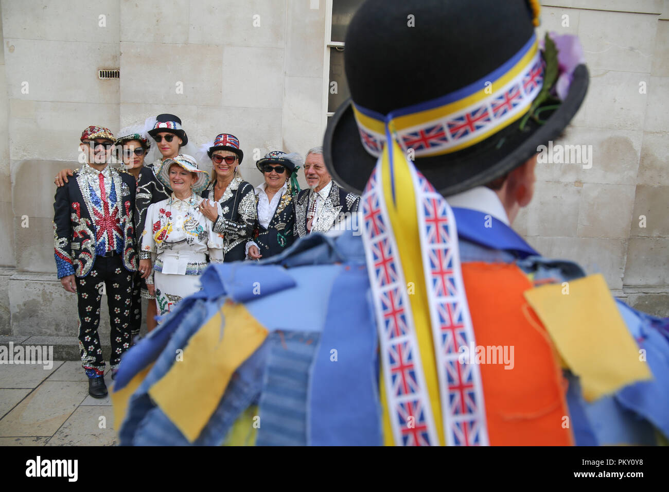 London UK  16 September 2018 Pearly Kings and Queens Harvest Festival at Guildhall Yard,Dressed in their best dark suits covered in hundreds of bright pearl buttons, the Pearly Kings and Queens of London got  together for the biggest event in the Pearly calendar, .@Paul Quezada-Neiman/Alamy Live Credit: Paul Quezada-Neiman/Alamy Live News Credit: Paul Quezada-Neiman/Alamy Live News Stock Photo