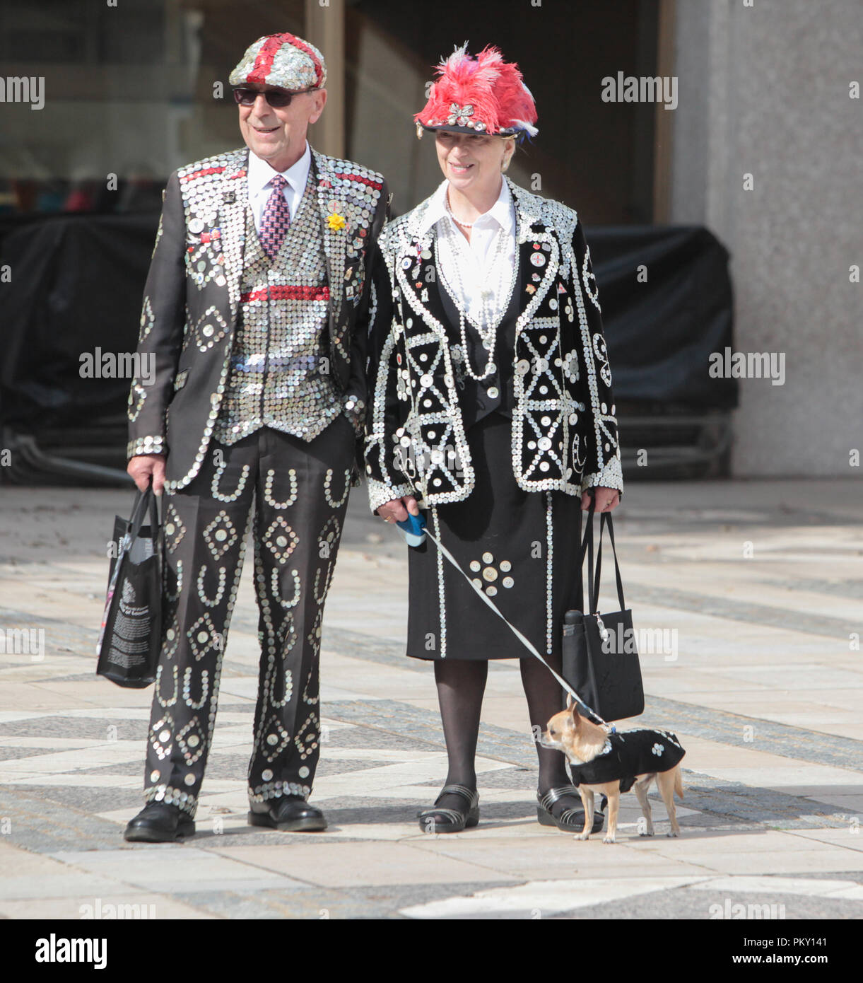 London UK  16 September 2018 Pearly Kings and Queens Harvest Festival at Guildhall Yard,Dressed in their best dark suits covered in hundreds of bright pearl buttons, the Pearly Kings and Queens of London got  together for the biggest event in the Pearly calendar, Credit: Paul Quezada-Neiman/Alamy Live News - Stock Image
