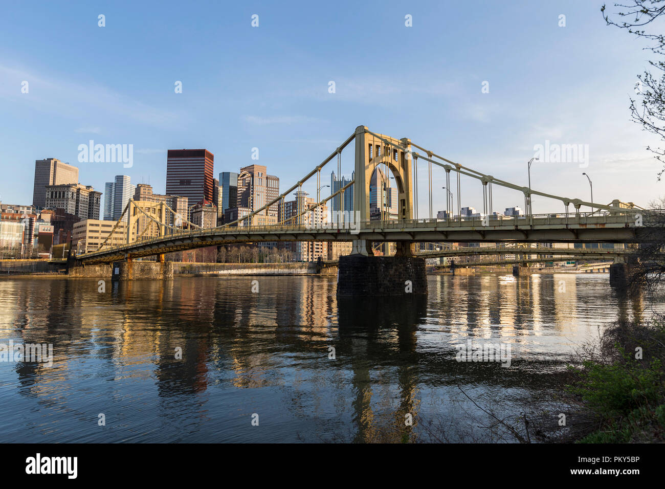 Urban waterfront and bridges crossing the Allegheny River in downtown Pittsburgh, Pennsylvania. Stock Photo