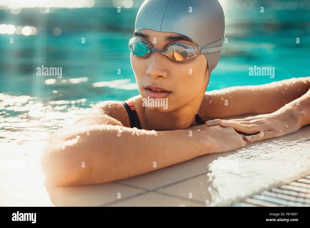 Caucasian Female Training In A Pool Stock Photos & Caucasian