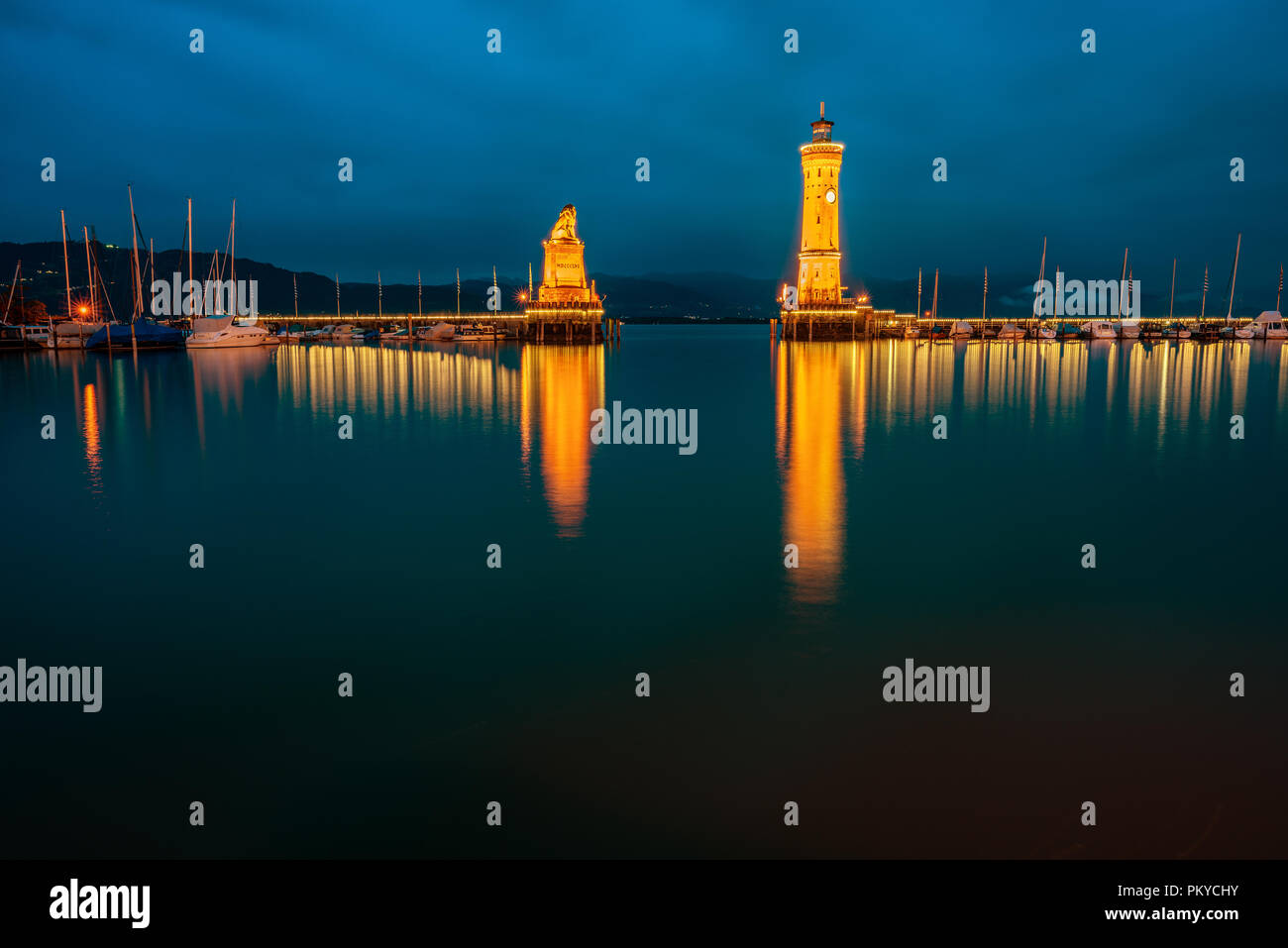 View of the harbor entrance and lighthouse in Lindau on Lake Constance. Stock Photo