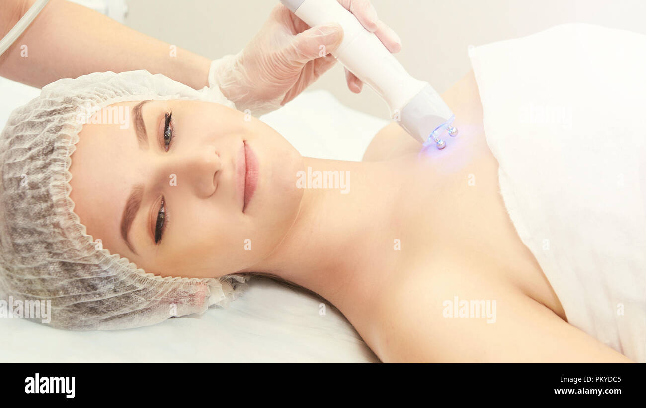 Cosmetology light equipment. Anti age and wrinkle. Microcurrent medicine treatment. Beauty woman. Sincare clinic. aesthetic peeling. - Stock Image