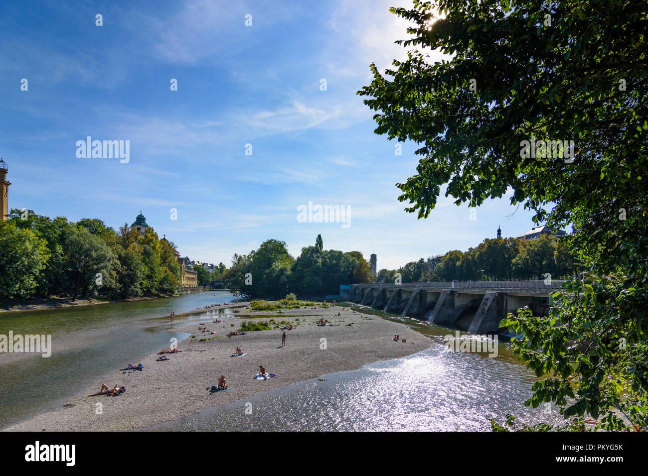 München, Munich: river Kleine Isar, sunbather, Wehrsteg, Oberbayern, Upper Bavaria, Bayern, Bavaria, Germany - Stock Image