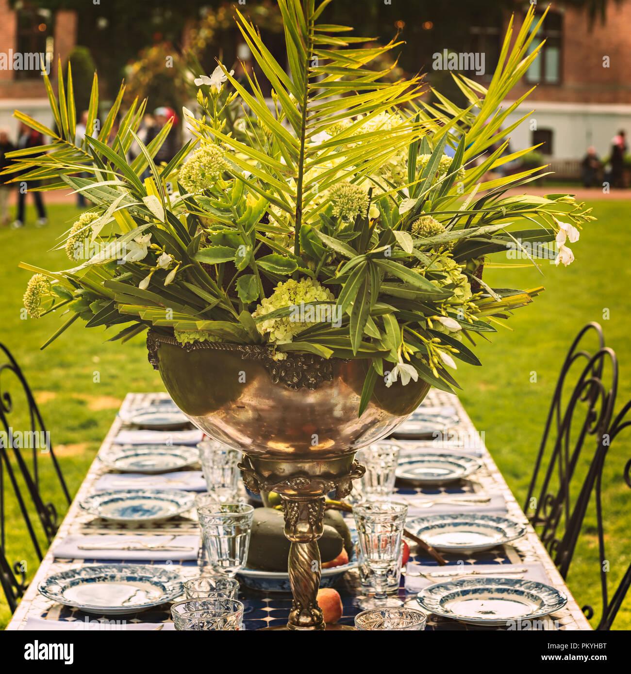 Rustic green garden party centerpiece. Stock Photo