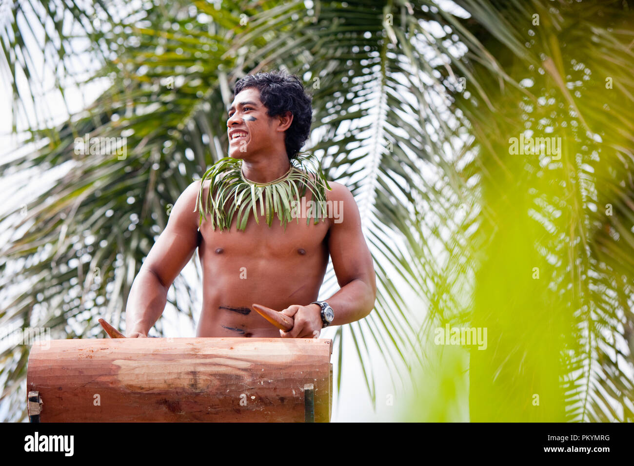 A traditional drummer performs at the opening of Teuila Festival 2012. - Stock Image