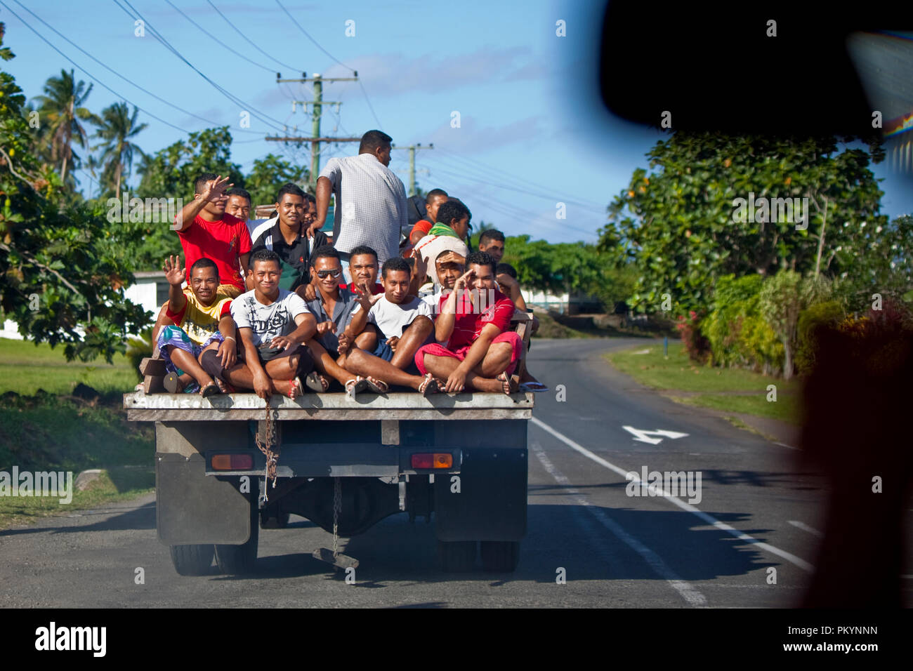 Locals hitching a ride on the back of a truck, Savai'i Island, Samoa. - Stock Image