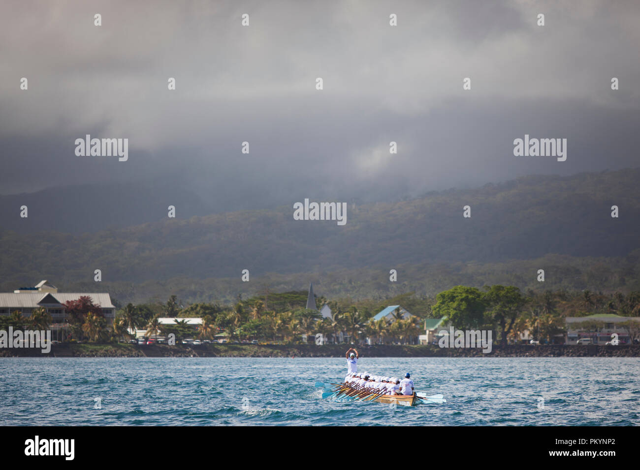 A fautasi (longboat) racing at full speed during the Fautasi Ocean Challenge 2012 (part of Teuila Festival). - Stock Image