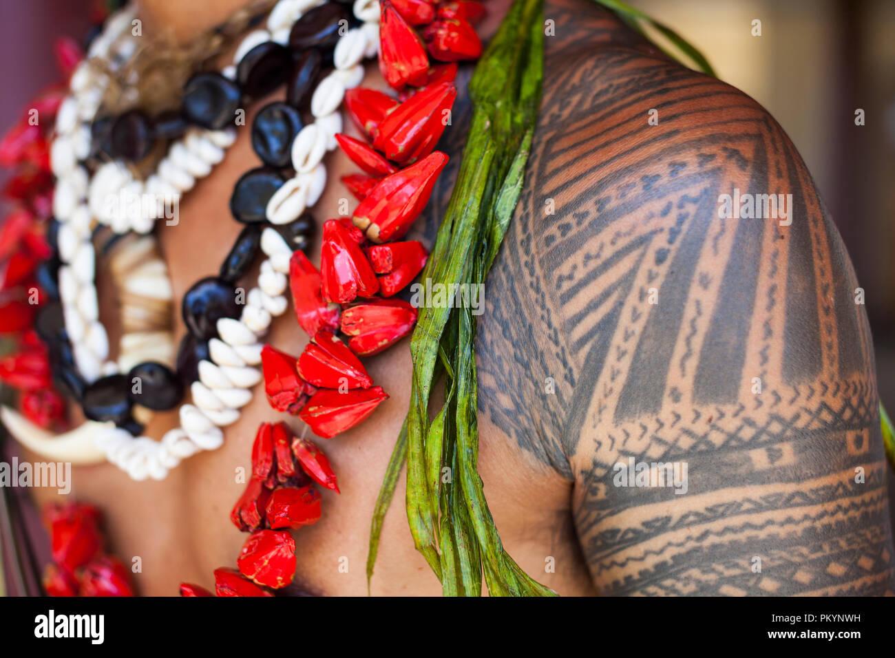 Local Samoan Chris 'Kilisi' Solamon wearing ulas (garlands) of seeds and shells. - Stock Image
