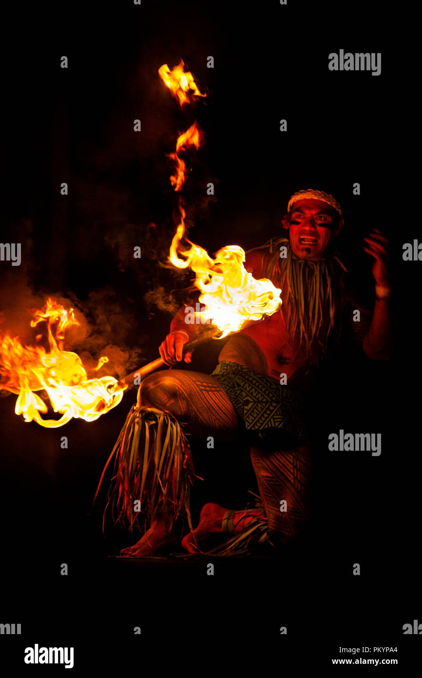 A Fire-knife dancer performs in central Apia for Teuila Festival 2012. - Stock Image