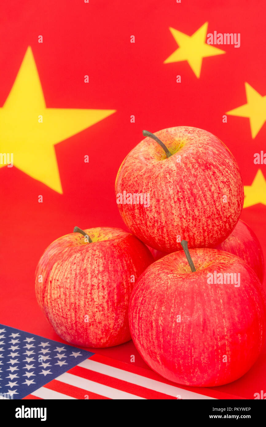 American flag + U.S red apple exports with Chinese flag - metaphor US apple industry, Chinese trade tariffs on U.S apple imports, & Trump trade war. - Stock Image