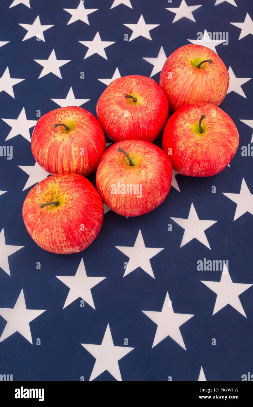 Red apples with US American flag / Stars and Stripes - metaphor US apple industry, Apple Day, and Chinese trade tariffs on imports of US apples. - Stock Image