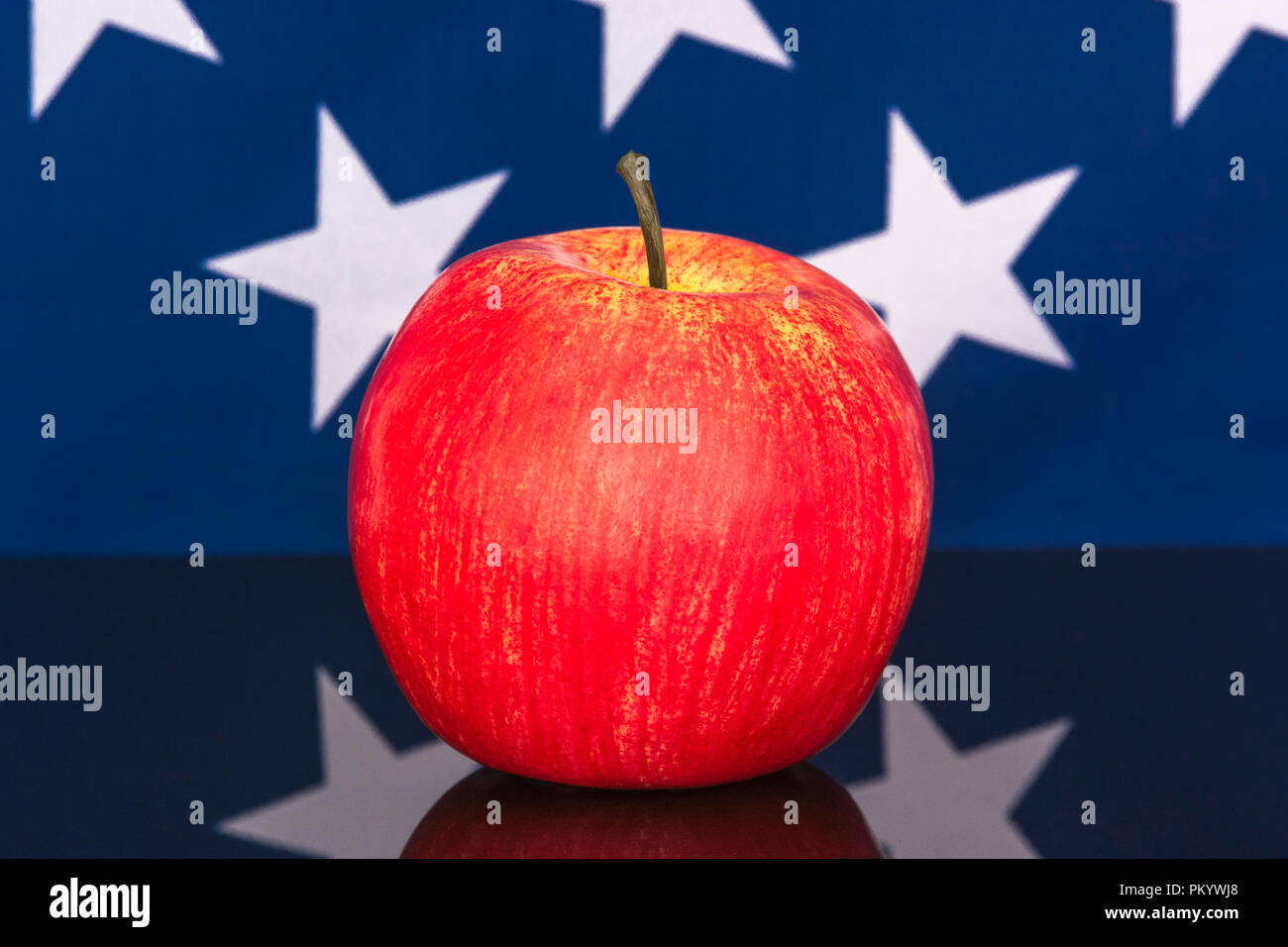 Red apples with U..S American flag / Stars and Stripes - metaphor US apple industry, Apple Day, and Chinese trade tariffs on imports of U.S. apples. - Stock Image