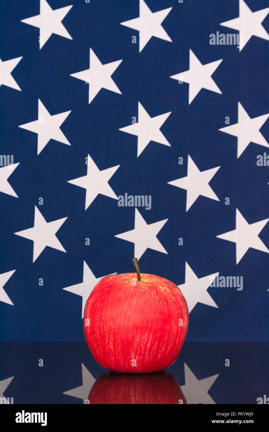 Red apples with U..S American flag / Stars and Stripes - metaphor US apple industry, Apple Day, and Chinese trade tariffs on imports of U.S. apples. Stock Photo