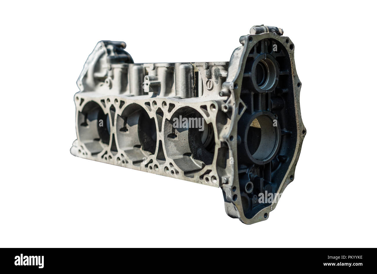 A disassembled of a three-cylinder engine block isolated on a white background with a clipping path. - Stock Image