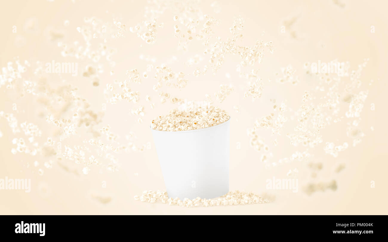 Blank white food bucket with popcorn mockup on yellow background blank white food bucket with popcorn mockup on yellow background depth of field effect 3d rendering empty pail with falling pop corn mock up maxwellsz